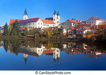 Morning view of Telc or Teltsch town mirroring in lake