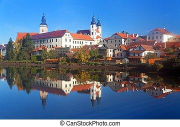 Morning view of Telc or Teltsch town mirroring in lake,...