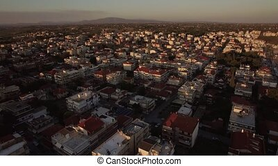Morning view of town with typical low-rise houses, Greece -...