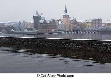 snow Charles bridge and Vltava in Prague