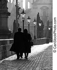Morning walk on Charles Bridge in Prague