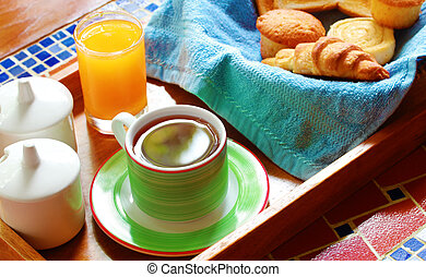Morning wholesome breakfast or brunch on table with freshly brewed hot beverage (coffee) and continental style cuisine made of croissant, cup cakes and bread slices toasted.