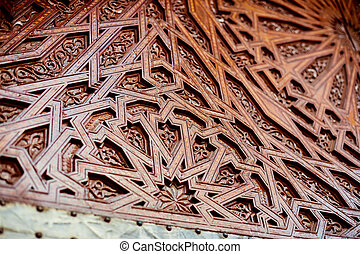 Moroccan architecture details an intricately carved wooden door