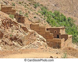 Moroccan berber village in the brown mountains, Setti Fadma...