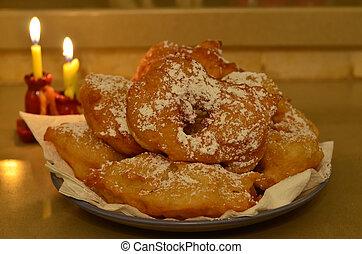 Hanukkah menorah (Hanukkiya) and donuts (sfingi)