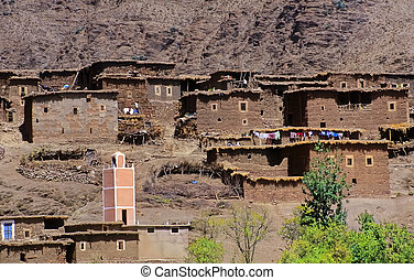 Moroccan village in the mountains with mosque