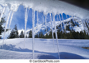 Breathtaking view of Slovak mountains behind huge icicles