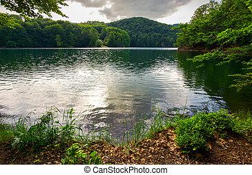 Morske Oko lake among primeval beech forest . beautiful...