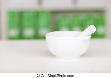 Mortar And Pestle On Pharmacy Counter - Closeup of white...