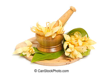 Mortar and pestle with champaka flower decoration for spa ...