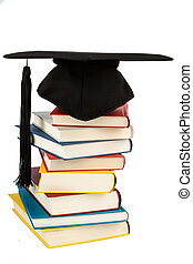 mortar board on books stack