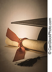 Mortarboard and Diploma Scroll Tied with Ribbon with Vintage Effect
