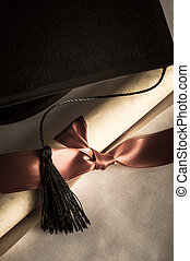 Mortarboard and Parchment Diploma Scroll Tied with Ribbon