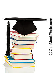 mortarboard on books stack - a mortar board on a pile of...