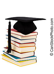 mortarboard on books stack - a mortarboard on a pile of...