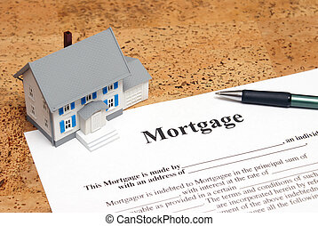 Mortgage - A conceptual image of a scale house and mortgage...
