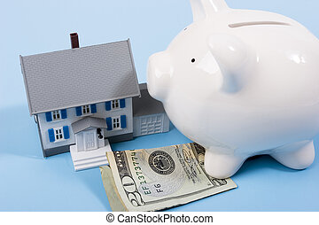 Two-story house with twenty dollar bill and a piggy bank