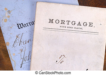 Vintage looking mortgage and warranty deed