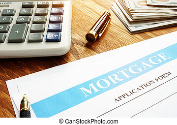Mortgage application form, calculator and money.