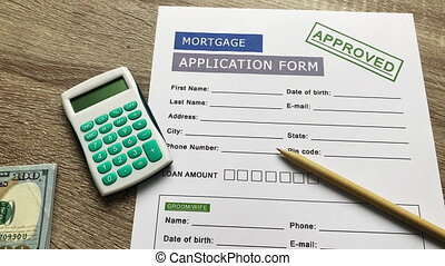 Mortgage application form on a wooden table.