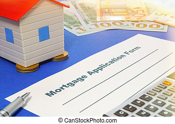Mortgage application form with a pen and house.
