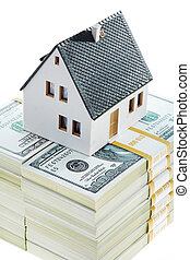 Mortgage - Close-up of toy house model on top of dollar...