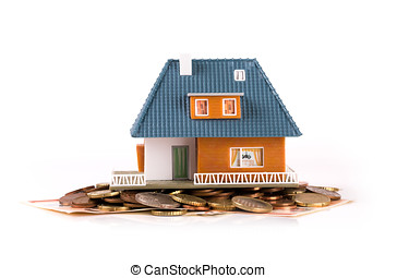 mortgage concept - house on heap of money