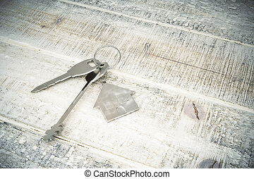 Mortgage concept - Top view of metal keys with house...