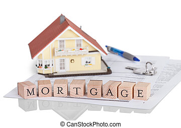 Wooden blocks spelling the word Mortgage on a legal document