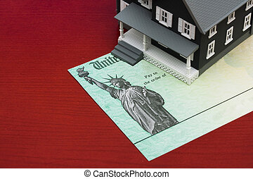 Mortgage deductions - House sitting on sitting beside a tax...