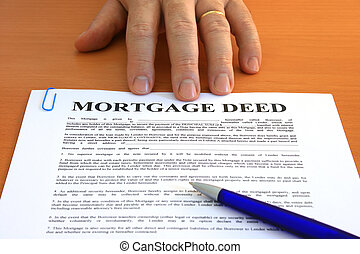 Mortgage Deed - Male hand presents a mortgage document