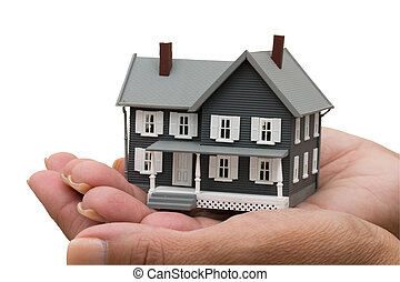 Mortgage Help - A model house sitting in hands isolated on a...