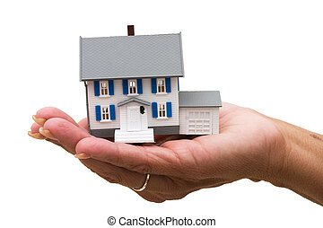 Mortgage Help - A model house sitting in hands on a white...