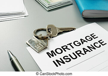 Mortgage insurance application form and pen.