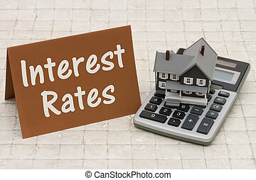 Mortgage Interest Rates, A gray house, brown card and...