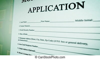 """Mortgage Loan Application Form on a paper sheet. """