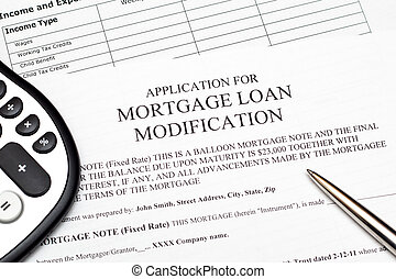 Application for a mortgage loan modification with pen and calculator.