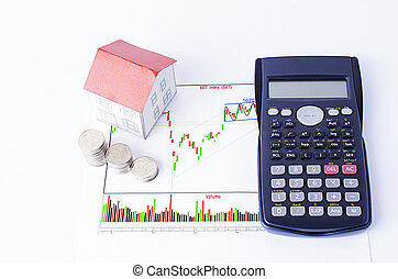 Mortgage loans concept with calculator and paper house and coins stack