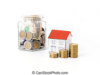 Mortgage loans concept with coins stack and paper house and saving bottle Isolated