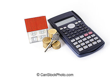 Mortgage loans concept with key and coins stack, paper house and calculator