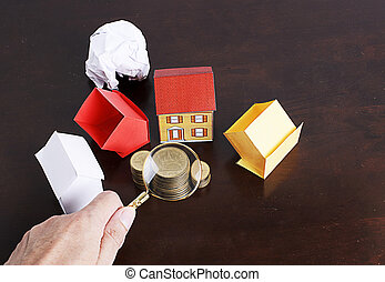Mortgage loans concept with paper house and coins stack
