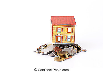 Mortgage loans concept with Paper house on coins stack