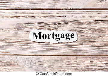 mortgage of the word on paper. concept. Words of mortgage on a wooden background