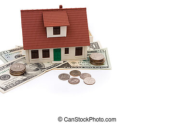 Mortgage Payment - A model house with money isolated on a...