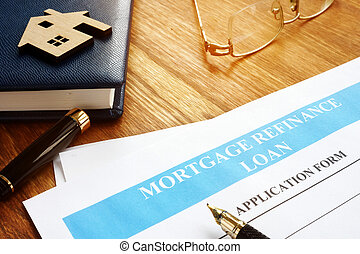 Mortgage refinance loan application form and pen.