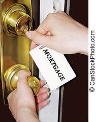 mortgage - woman unlocks door with mortgage keychain