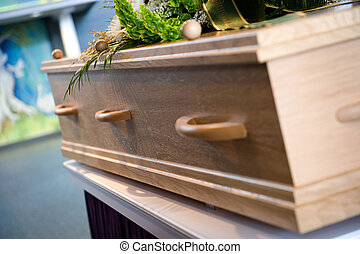 Mortuary - A coffin with a flower arrangement at a mortuary