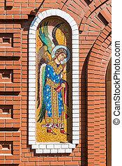 Mosaic icon on the brick wall of orthodox church