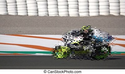 Mosaic motorbike competing in a racing circuit and slow-mo -...