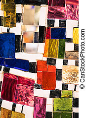 Mosaic of colored glass pieces.
